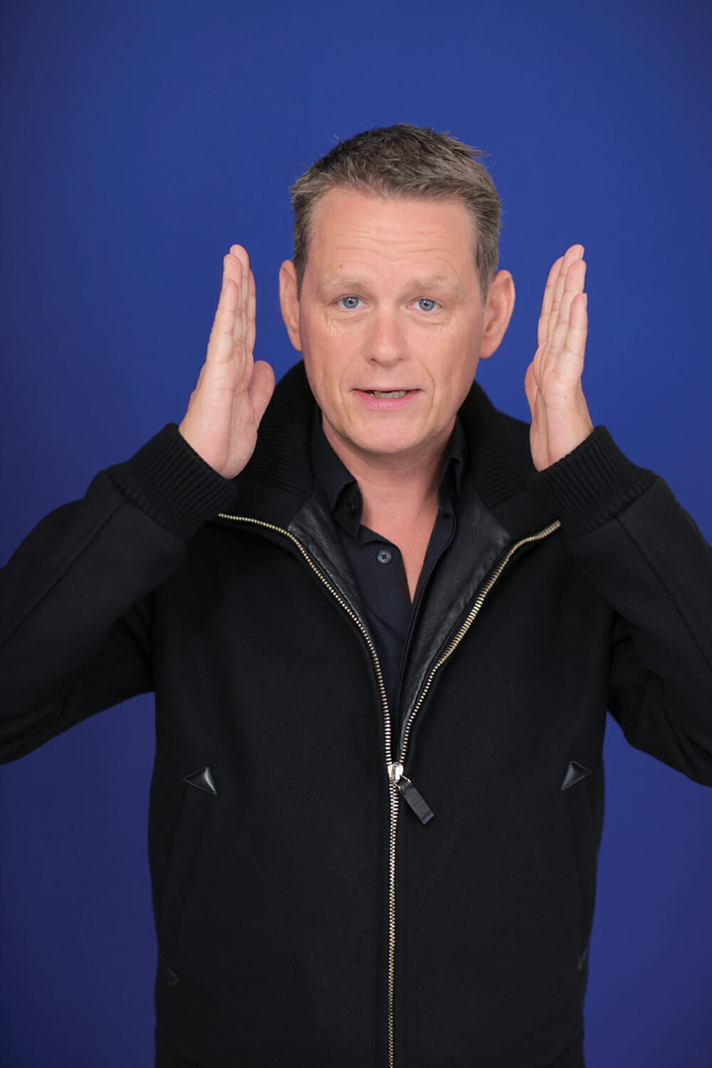 Martin Lindstrom portrait with blue background - Photo Library
